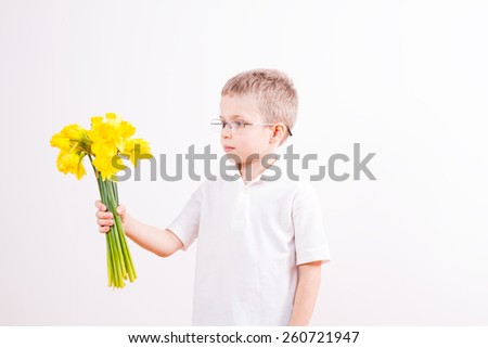 Young boy with yellow folowers - stock photo