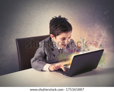 Young boy working with laptop. concept of creativity and imagination - stock photo