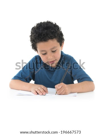 Young Boy Writing His Homework Isolated on White Background - stock photo