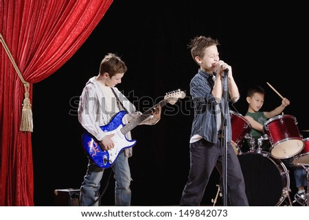 Young boys performing in band - stock photo