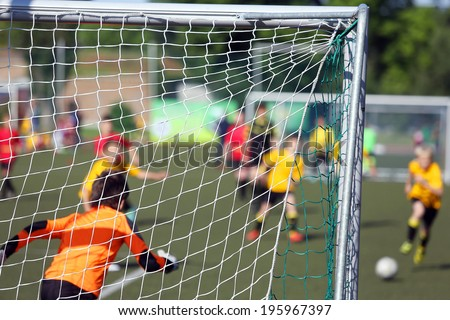 Young boys play football match - stock photo