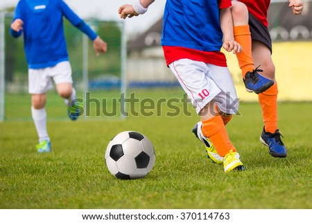 Young Boys Playing Soccer Football Match. Football soccer training match for young boys. - stock photo