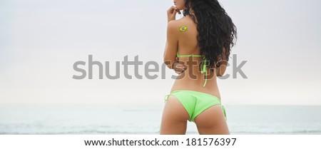 young brazil supporter beautiful bikini girl beach soccer world cup - stock photo