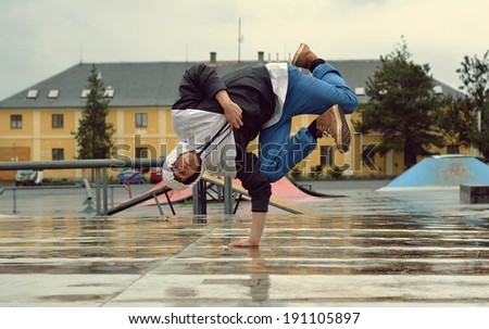 Young breakdancer on the street - stock photo