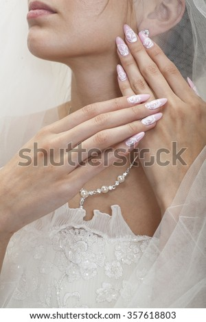 Young bride hands with beautiful manicure   - stock photo