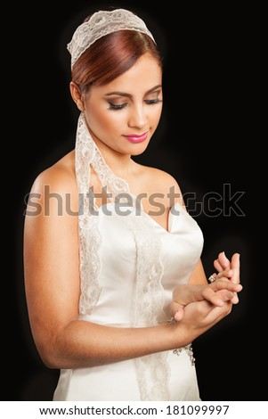 young bride looking at wedding ring - stock photo