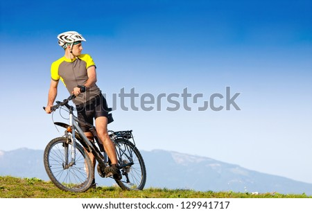 Young bright man on mountain bike - stock photo