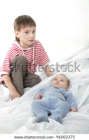 young brother and newborn baby portrait - stock photo