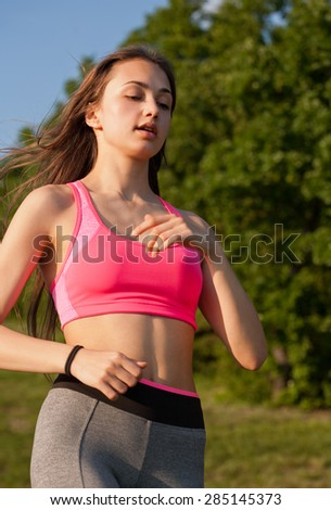 Young brunette beauty enjoying outdoors exercise in nature. - stock photo