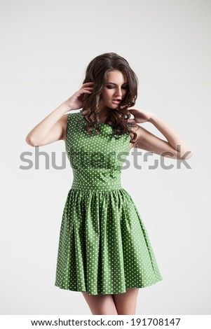 Young brunette girl in color dress. Fashion portrait in studio. Sexy beautyful dress - stock photo