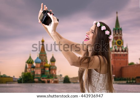 Young brunette girl taking selfie photo in Moscow, Russia - stock photo