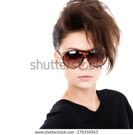 Young brunette lady in black dress with sunglasses  - stock photo
