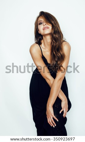 young brunette pretty woman in black dress posing on white background with make up. stylish girl - stock photo