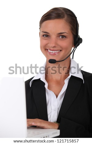 Young brunette with headphones and microphone - stock photo