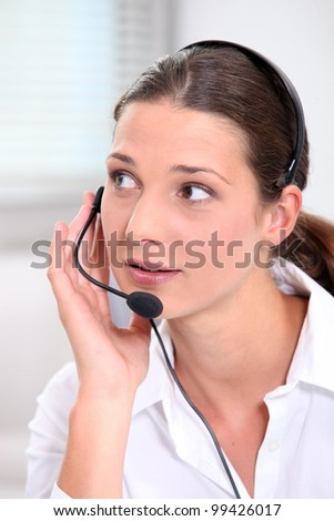 Young brunette with microphone - stock photo
