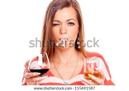 Young brunette with three cigarette, whiskey and red wine, isolated on white - vices concept - stock photo