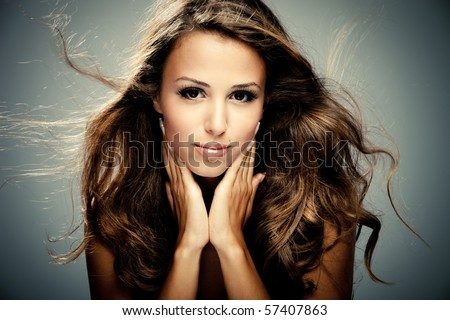 young brunette woman beauty portrait  studio shot - stock photo
