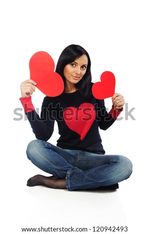 Young brunette woman in black sweater with red hearts isolated on white - stock photo