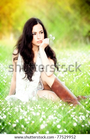 young brunette woman in field, summer day, sunset - stock photo