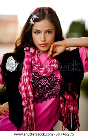 young brunette woman outdoor portrait - stock photo