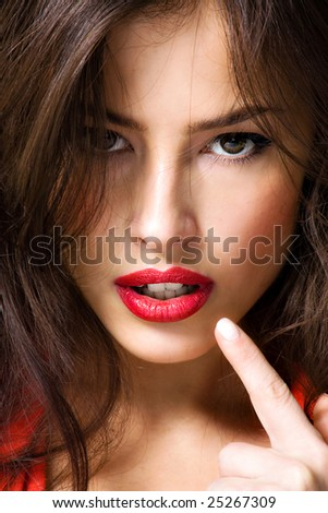 young brunette woman showing her lips - stock photo