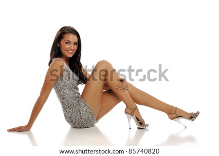 Young Brunette Woman Wearing a short dress isolated on a white background - stock photo