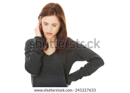 Young brunette woman with a headache - stock photo