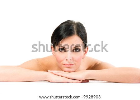 Young brunette woman  with piercing look watching to you - stock photo