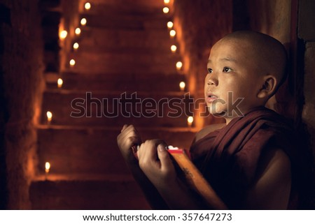 Young Buddhist novice monks learning Buddhist teaching  inside monastery, pagan, Myanmar. - stock photo