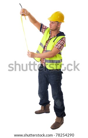 young builder in vest and yellow hardhat measure something, isolated on white - stock photo