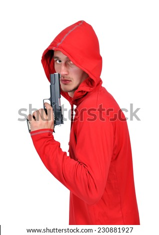 young burglar with gun on a white background - stock photo