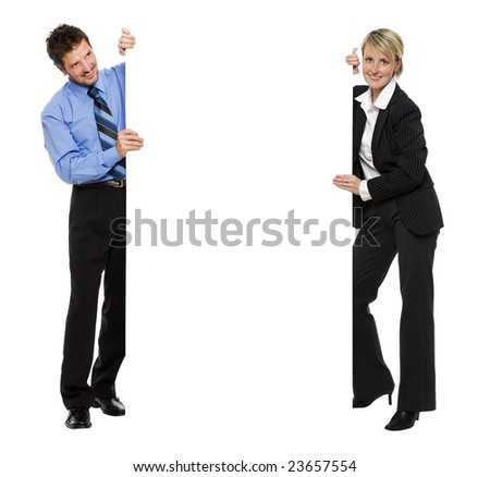 young business couple holding empty advert sign - stock photo