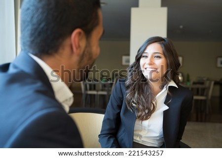 Young business couple meeting with digital tablet - stock photo