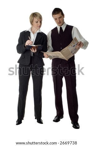 young business couple reading newspaper and writing on white - stock photo