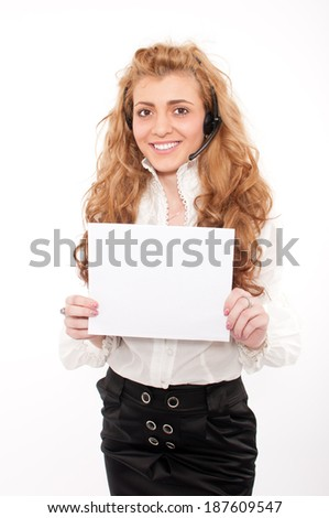 Young business female customer service representative holding white empty paper sign - stock photo