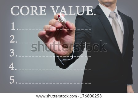 Young business hand with pen mark core value   - stock photo