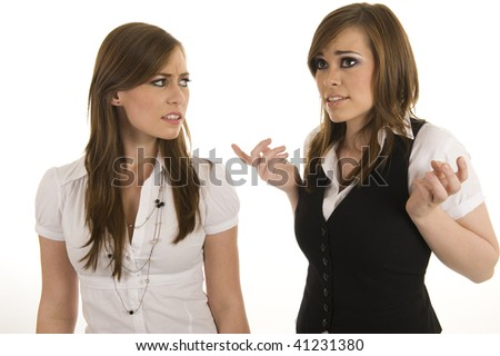 Young business ladies arguing. Studio on isolated white background. - stock photo