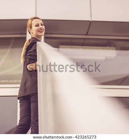 Young business lady going to work - stock photo