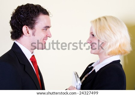 young business man and woman portrait - stock photo