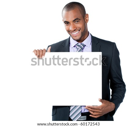 young business man behind an white add space - stock photo