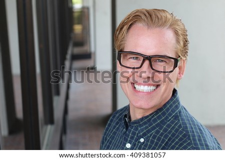 Young business man close up over office space modern background. Looking confident - stock photo