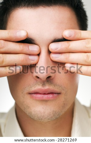 young business man covering his eyes close up shoot - stock photo