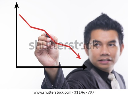Young business man draws a ascending graph chart - stock photo