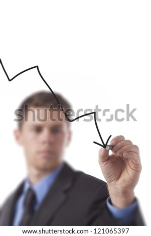 Young business man draws a descending arrow isloated on a white background. - stock photo