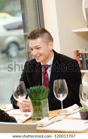 Young business man during lunch time smiling - stock photo