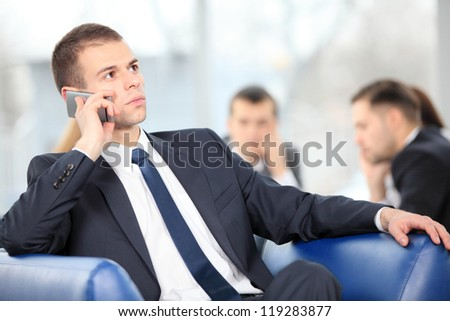 Young business man enjoying a conversation over cellphone - stock photo