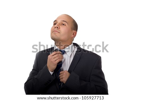 Young business man fixing his tie before going to work - stock photo