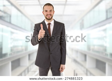 young business man going thumb up, at the office - stock photo
