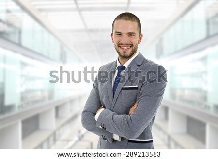 young business man happy at the office - stock photo