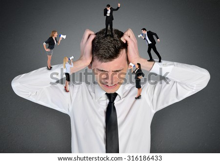 Young business man headache scream - stock photo